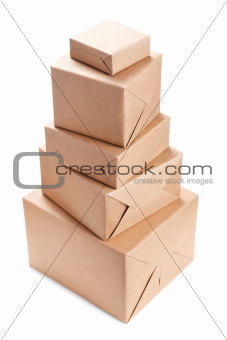 Stack of parcel wrapped with brown packing paper