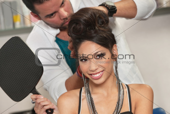 Happy Woman in Salon Holding Mirror