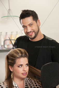 Handsome Male Hairdresser with Client