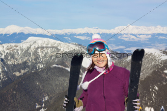Pretty girl in mountains skiing