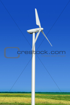 green meadow with wind turbine