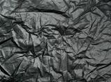 Crumpled cloth texture closeup background.