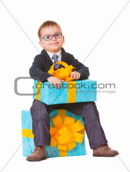 Small boy in spectecles with two big presents