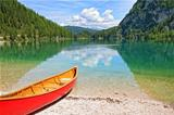 Lake Lago di Braies with canoe in Dolomiti Mountains - Italy Eur
