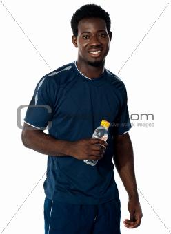 Handsome man holding water bottle