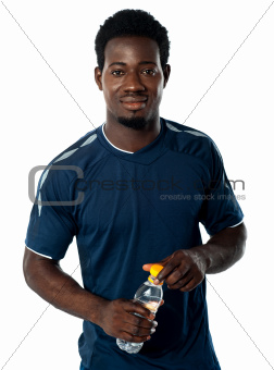 Fit man posing with water bottle