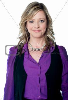 Smiling pretty senior female executive