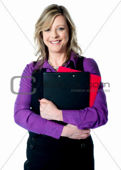 Corporate woman holding documents tightly