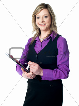 Portrait of experienced lady writing on clipboard