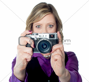 Portrait of a beautiful woman with camera