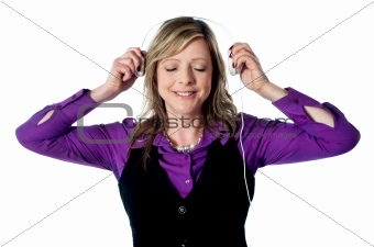 Lady enjoying music through headphones