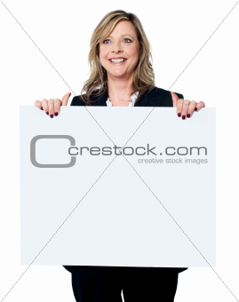 Female business professional holding blank billboard