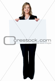 Senior beautiful woman smiling showing blank white placard