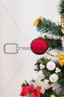 Closeup on Christmas tree with big red Christmas ball