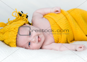 newborn girl in yellow cap
