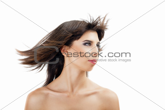 beautiful young girl with flying hair and fashion makeup on white background