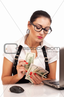 Attractive young businesswoman gives money