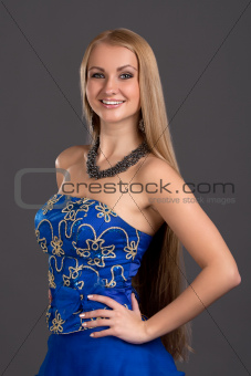Young beautiful woman in blue dress