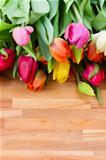 spring tulips on wooden table