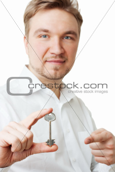 young man holding key