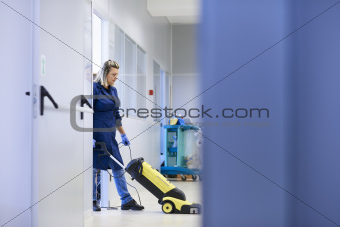 Women at workplace, professional female cleaner washing floor in