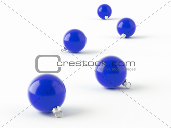 row of blue christmas balls on white background