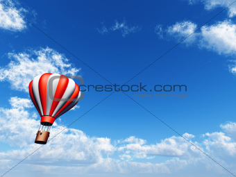 bright balloon is in blue cloudy sky