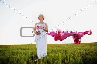 young pregnant woman in a white greek dress
