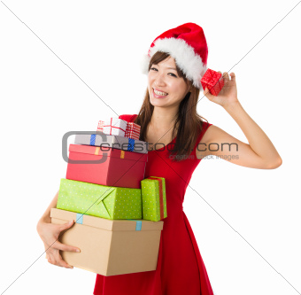 beautiful asian girl with plenty of gifts during christmas