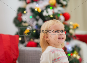 Portrait of baby near Christmas tree