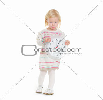 Christmas portrait of baby girl holding clock