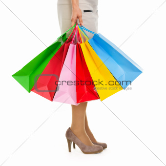 Closeup on shopping bags in woman hand