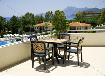 table and chairs in tourist resort in a hot canicular day