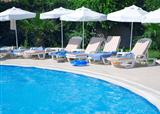 tourist resort with pool and white parasols
