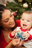 Young Attractive Ethnic Woman With Her Newborn Mixed Race Baby Near The Christmas Tree.