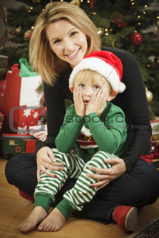 Attractive Young Mother and Baby Son Christmas Portrait.