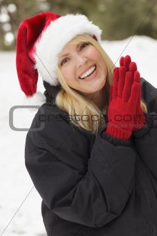 Attractive Woman Having Fun in the Snow on a Winter Day.