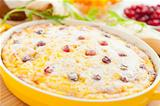 Curd pudding with cranberries and raisins close-up in dish