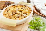 Vegetables Pie with mushrooms, potatoes and cheese on a pan