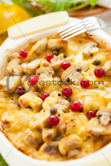 Baked vegetables. Mushrooms, potatoes, cranberries and cheese on a pan