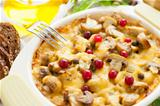 Vegetables gratin with mushrooms, potatoes, cranberries and cheese