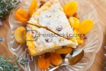 Cheese cake with dried apricot and raisins close-up on a plate