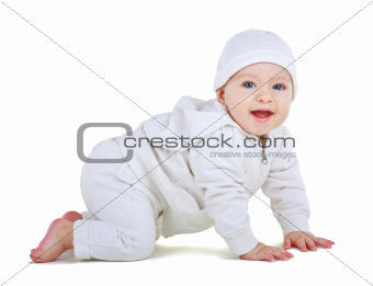 Child in a white suit crawls