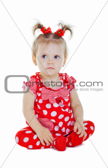 A small child in a red dress