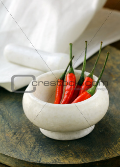 red hot chili peppers in a marble mortar
