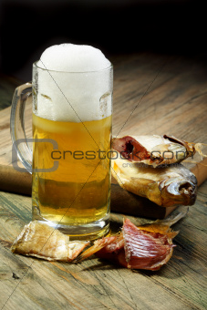 Salted fish and a full glass of beer.