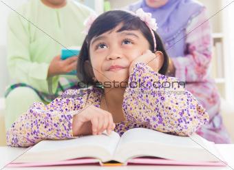 Asian family reading book
