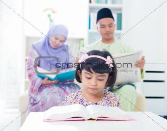 Muslim family reading.
