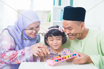 Asian family playing music instrument