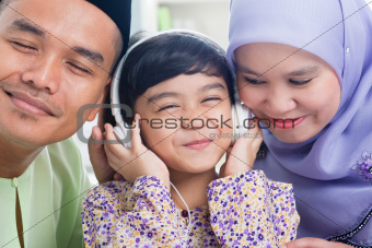 Asian family listen mp3 headphone